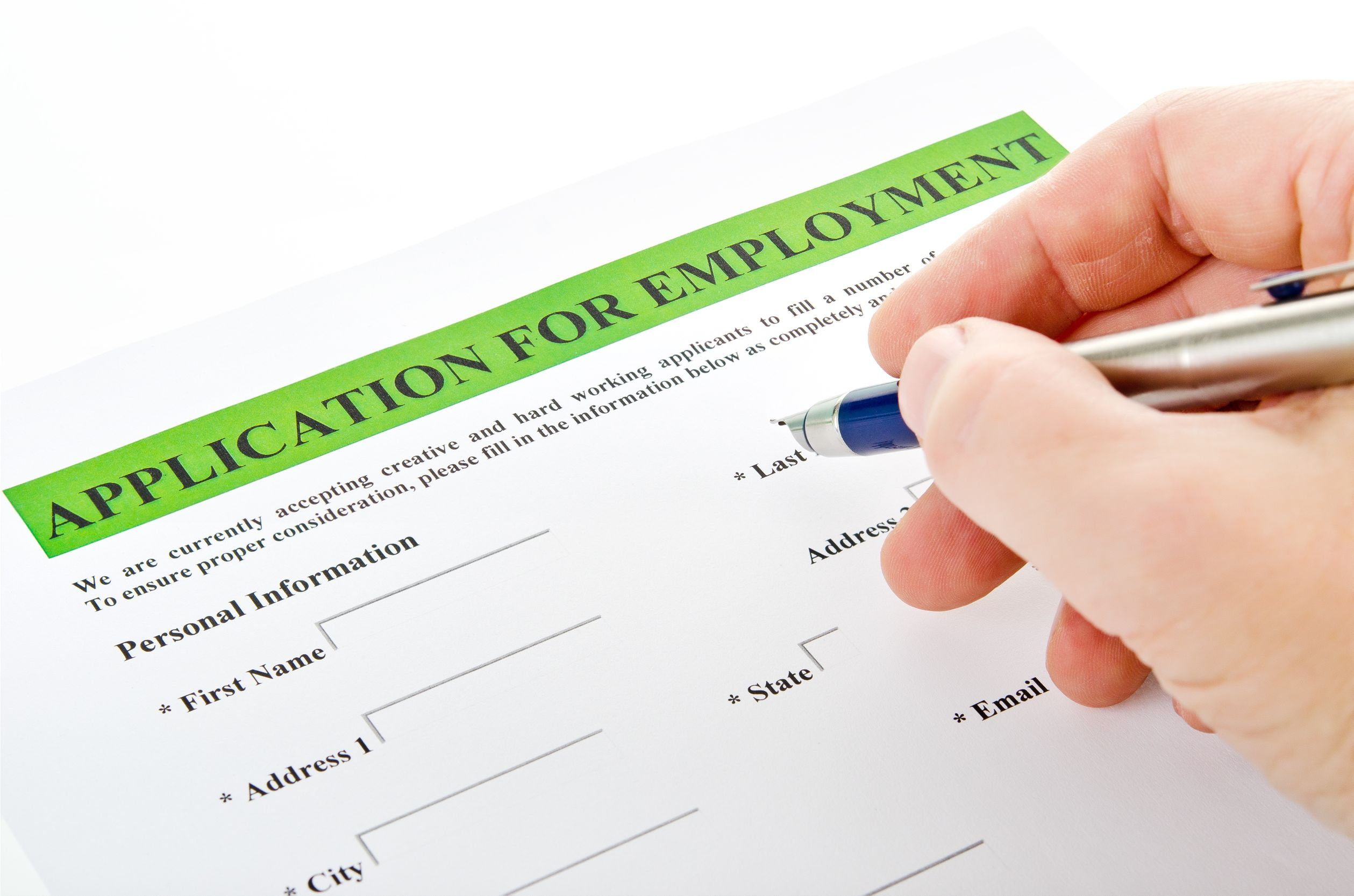 Man-filling-out-an-application-form -